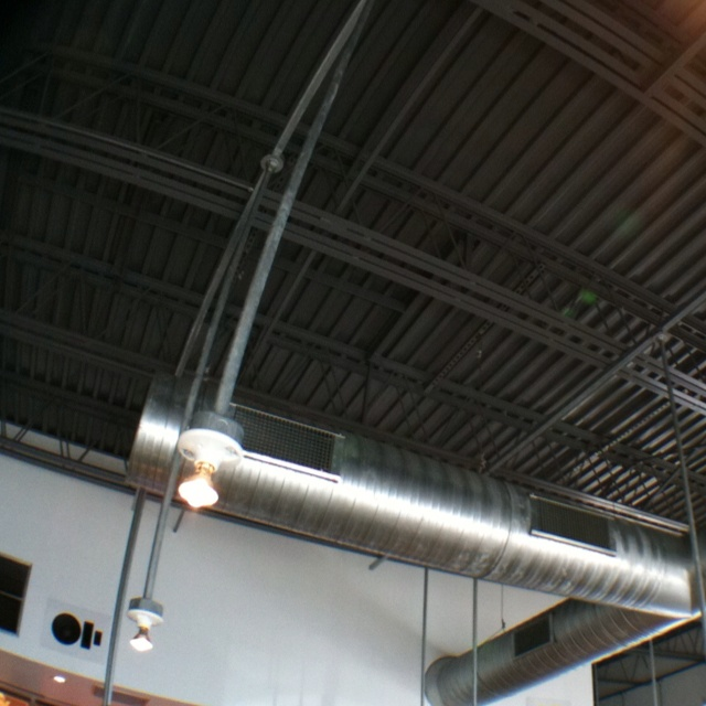 Exposed Ductwork And Ceiling Painted Dark