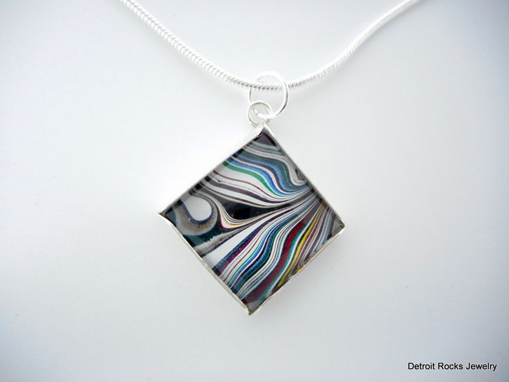 Fordite Necklace. Fordite Jewelry.  Motor City Agate.  Sterling Silver Necklace. Made in Detroit. by DetroitRocksJewelry on Etsy https://www.etsy.com/listing/288084181/fordite-necklace-fordite-jewelry-motor