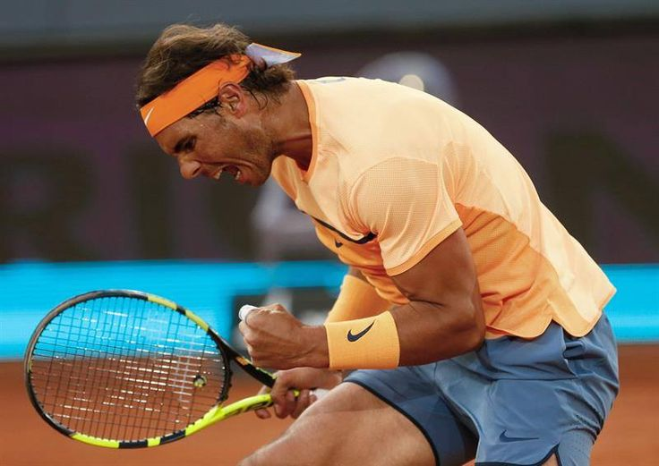 Rafael Nadal drew on his battling qualities on Thursday at the Mutua Madrid Open to keep alive his chances of winning a 29th ATP World Tour Masters 1000 title. The fifth seed and four-time former titlist produced a stunning comeback in the first set against Sam Querrey for a 6-4, 6-2 victory and a place in the quarter-finals, where he will face Joao Sousa.  Photos: Mutua Madrid Open; Getty Images; REUTERS; EPA; AFP; BPI Rafa Nadal ATP Tennis Madrid Open 1000 Vamos Rafa