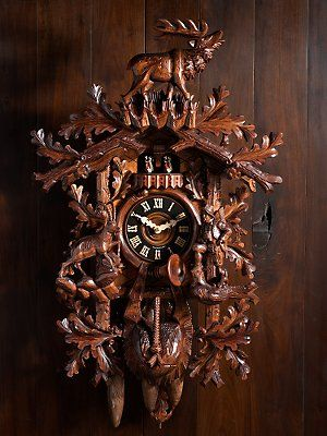 Ornately carved cuckoo clock.