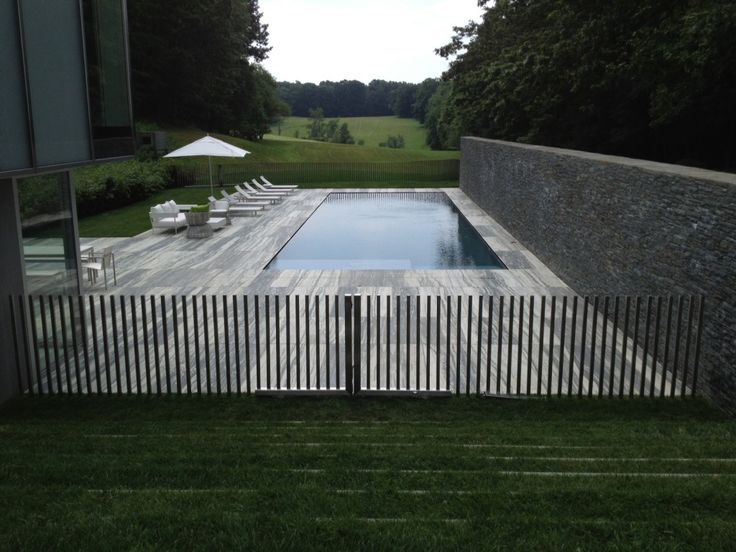 custom stainless steel fence design. I also really like the pool deck paving