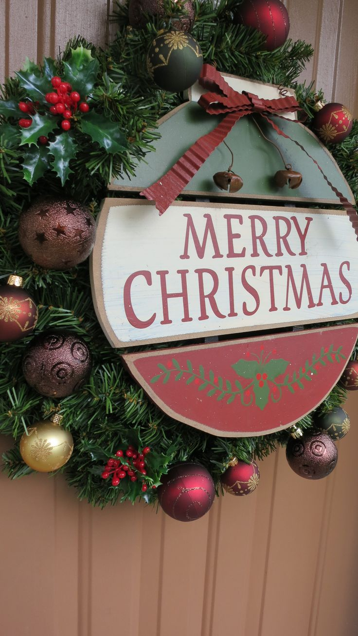 The Wreaths Center Is A Wooden Ornament Sign That Says Merry Christmas  Shatterproof Ornament Balls