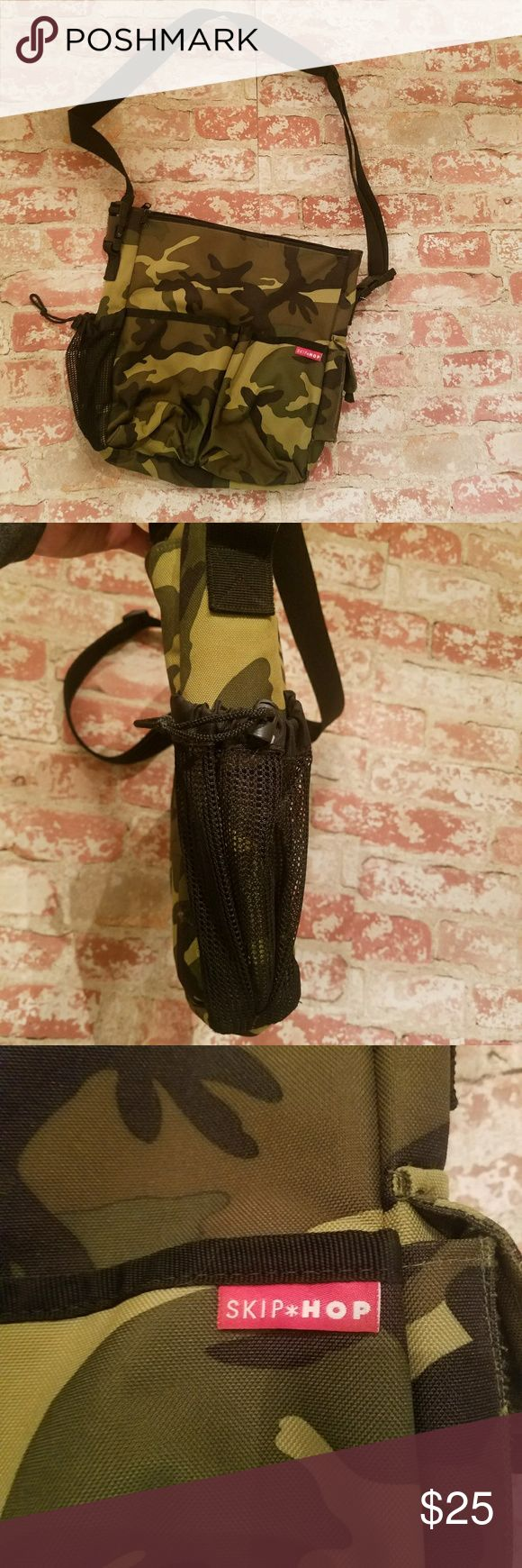 """Skip Hop camo diaper bag Clean and in excellent condition with the exception of minor wear on one side pocket.  See pic.  Changing pad not present Stylish diaper bag also has straps that allow it to be easily attached to stroller Reasonable offers considered  12.5"""" wide 14""""tall 3"""" deep  Lots of pockets! Skip Hop Bags"""