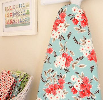 I love the vintage fabric and beautiful color combination on this floral ironing board cover.