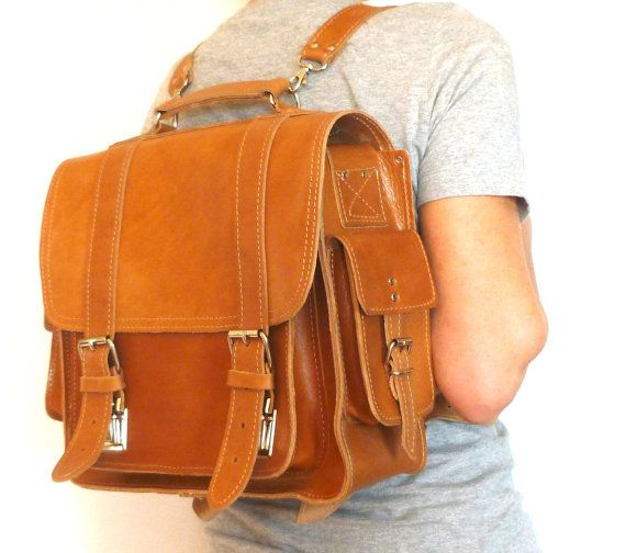 This briefcase backpack is made of high quality genuine cowhide leather.  It has one front pocket, two side pockets, one back and one inside zippered