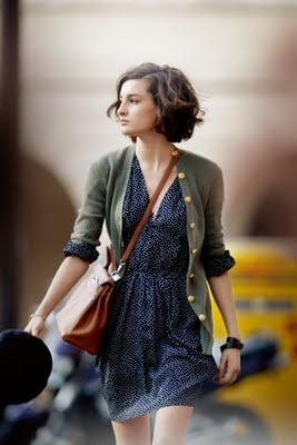 Blue dress, green cardigan, amazing leather bag, and great short brown brunnette curly do