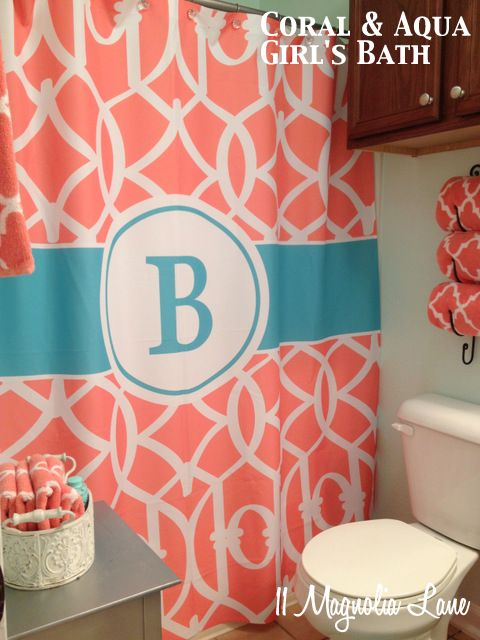 """Aqua and coral bathroom with monogrammed trellis shower curtain--nice """"beachy"""" cheerful colors"""