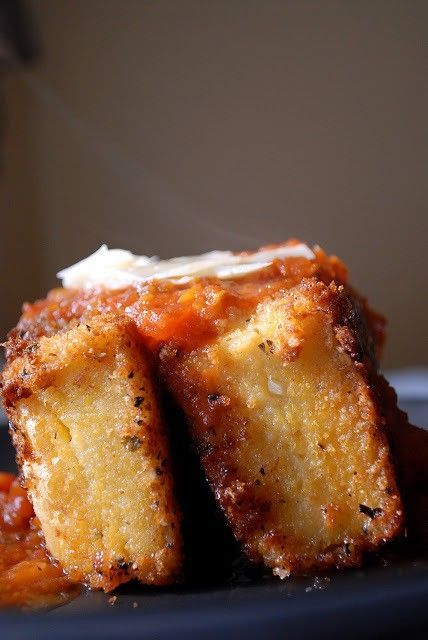 Fried Grit Cakes are a delicious way to serve up cheesy grits and are delicious covered in marinara sauce and a little Parmesan cheese. Do you know who Thomas Keller is? No? Ever heard of The French Laundry in Napa…