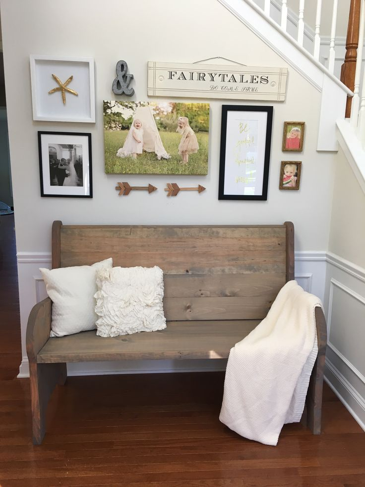 Entryway with church pew bench and gallery wall.