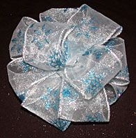 This was a pretty good tutorial, I will post my picture :)  How to make a big fluffy bow