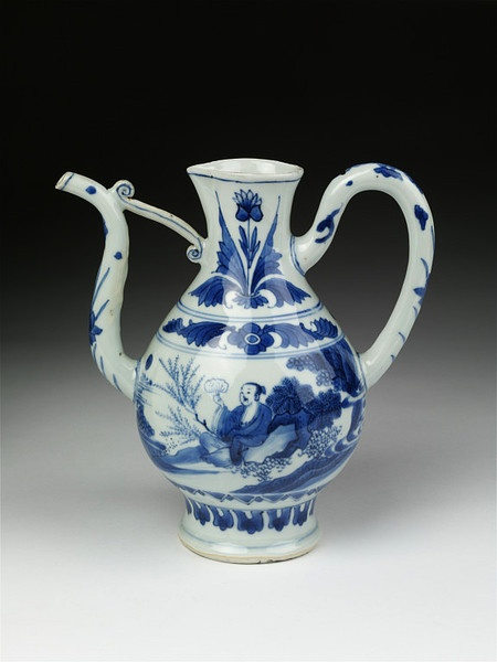 EWER. China cira 1625-1650. This squat, globular form ewer is painted in typical 'transitional' style, using washes of cobalt blue, in a variety of shades to depict figures in a landscape. The neck, spout and handle are decorated with floral motifs that echo the floral designs seen on Ottoman Iznik wares. Such motifs are commonly found on blue and white Chinese ceramics of this period. The spout, supported by a scroll shaped strut is characteristic of late Ming ewers.