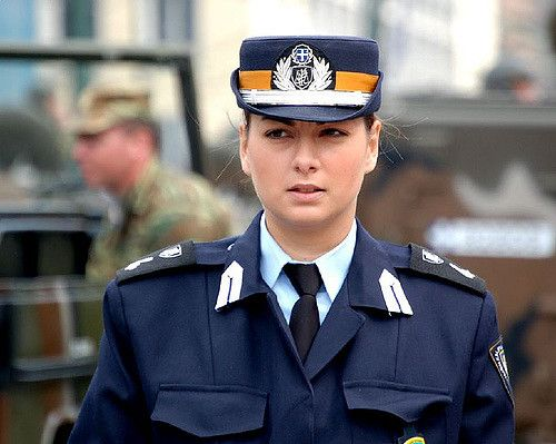 https://flic.kr/p/c4nUR | Girls in Uniform | Crowd control marshall - seems a little unsure of her authority.
