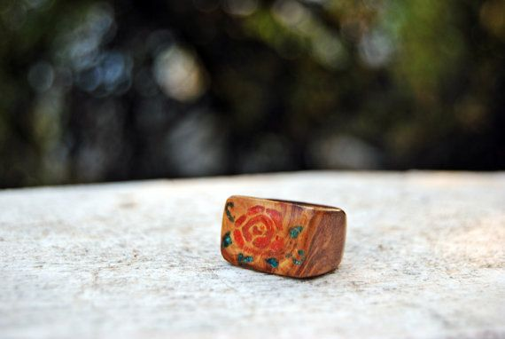 Olive wood ring with a rose inlayed with red coral and chrysocolla. by Working*Projects