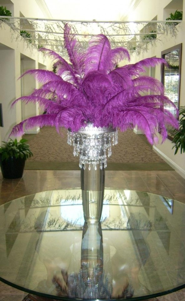 This is a fun way to incorporate radiant purple hued feathers into your event. I can totally see hiding adding an LED light in there making it light up like a lamp.