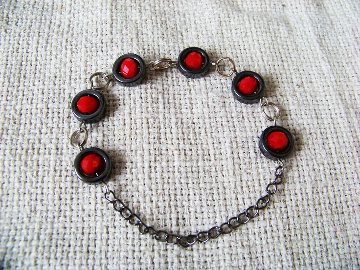 Red bracelet. Hematite and little rubies.