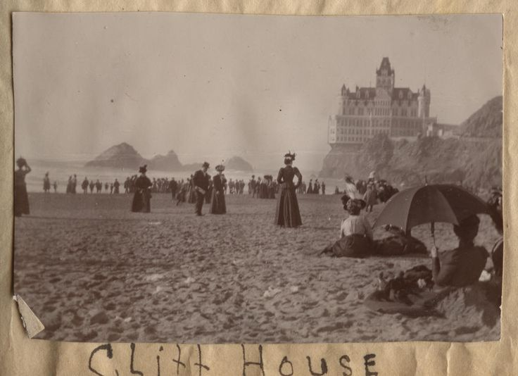 Life at the beach in San Francisco - around 1900.  Sutro's Cliff House in background.