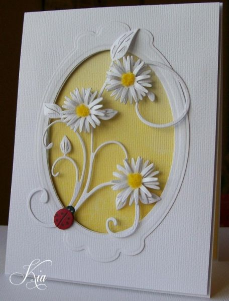 handmade card ... Aster Flourish by kiagc ... mostly white with some yellow and a pop of red ,,, nesties labels dies for frame with oval cut out ...yellow in negative sapce ... sweet Memory Box asters with yellow Flowersoft centers ... die cut flourish with leaves ,,, ladybug ,,, awesome card ... beautifully crafted ,,,