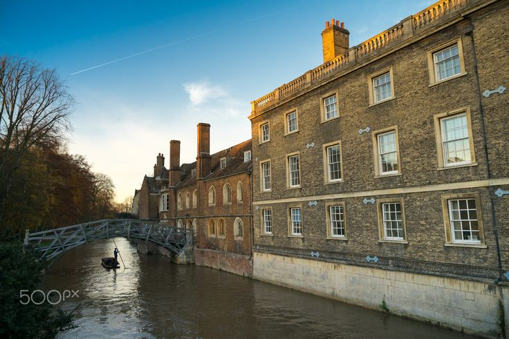 Punting on the river Cam and the Mathematical Bridge, Queens college, Cambridge in the depths of Autumn.