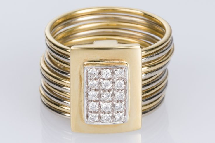 Damiani 10 band ring with a combination of 18k white and yellow gold. Gorgeous design and so interesting to look at.  Available on 1st Dibs - The Jewellery Trading Company