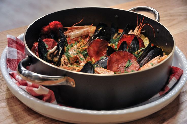 Paella is basically a risotto but with more ingredients! It is a traditional Spanish dish! It's important to prep and organize all the ingredients properly.   Finely chop an...