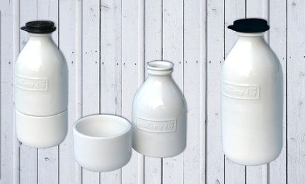 Vintage-styled white milk bottles charmingly serve or store milk, cream, juice, or sugar $7