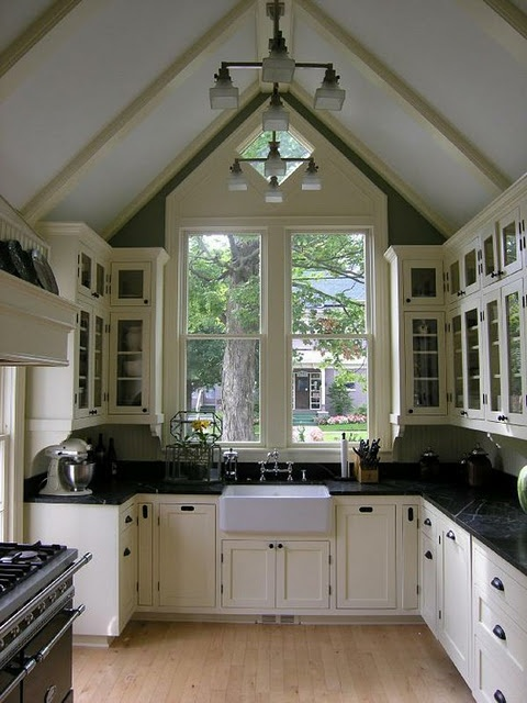 Long narrow kitchen is opened up with this awesome ceiling and window.