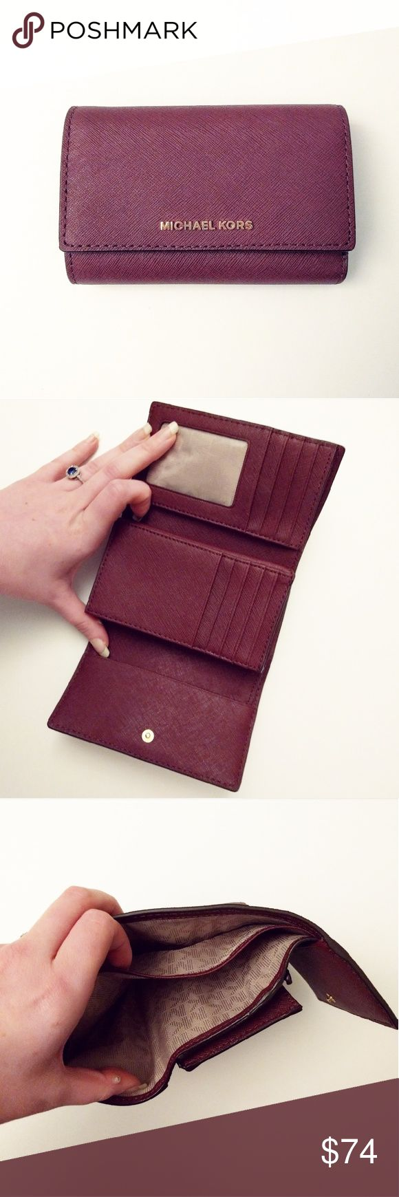 MK Jet Set Travel Medium Leather Wallet Brand new, never used. This is a super cute burgundy plum wallet, perfectly sized for any purse or to carry! It has 8 card slots, an ID slot, and zippered coin pocket, and two sleeves for cash. MICHAEL Michael Kors Bags Wallets