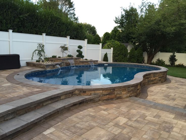 Radiant 16x27 Semi-Inground Freeform with Radiant Inside step and water feature