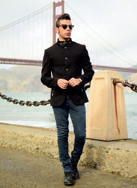 Shop this look on Lookastic:  http://lookastic.com/men/looks/dark-green-boots-black-military-jacket-black-sunglasses-navy-skinny-jeans/7419  — Dark Green Leather Boots  — Black Military Jacket  — Black Sunglasses  — Navy Skinny Jeans