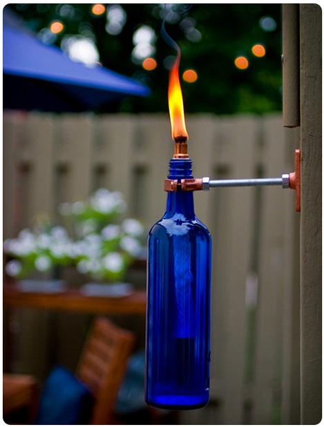 Up-cycled wine bottle outdoor torch.  So simple!