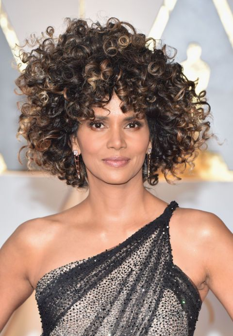 Halle Berry voluminous ombre curls are the best curls we have seen in forever. The perfect light brown highlights to start off the spring season.