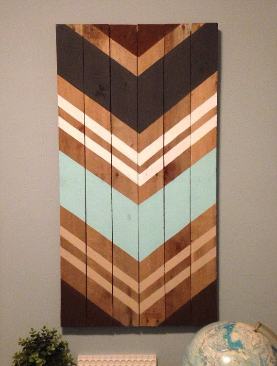 Brown, tan, dark gray, light aqua and white adorn this reclaimed wood art piece. This large piece is 39x20.5 Each completed art piece will vary