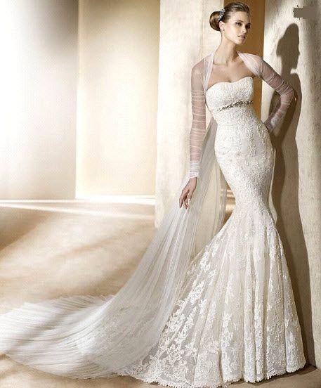 Strapless, lace mermaid wedding dress with sheer long sleeved bolero.