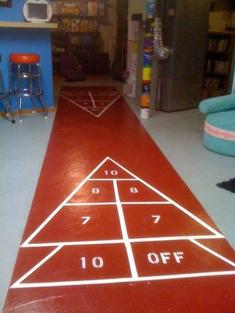 Paint your own shuffleboard court:  http://retrorenovation.com/2010/10/14/how-to-paint-your-own-shuffleboard/