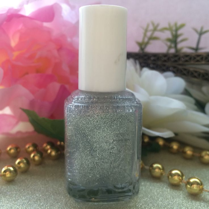 TAKEALOT MINI HAUL - ESSIE - SILVER BULLIONS - Night on the town? slip on this luminescent silver nail polish with glittery sheen, it's the perfect shimmery party dress for nails