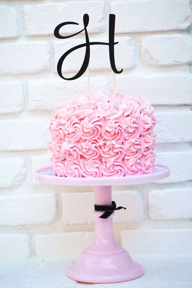 Pretty pink rose cake at a modern 50's birthday party! See more party ideas at CatchMyParty.com!