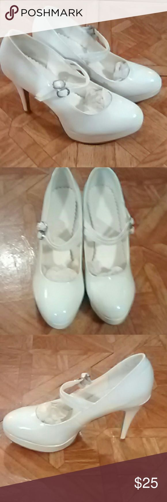 "White patent high heel shoes Brand new,never worn. Size 7.5 women's white patent shoes. With 4"" heel. Like new condition, always kept in their bag. unbranded Shoes Heels"