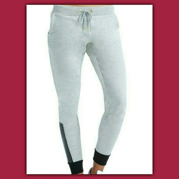 Joggers With Faux Leather These super soft french terry joggers feature faux leather detailing with Anaconda texturing at the ankles. Pair with a matching hoodie to complete the Barbz Fave look. French terry material Faux leather detailing around ankles Drawstring waist Machine wash Ankle length Nikki Minaj  Pants Track Pants & Joggers