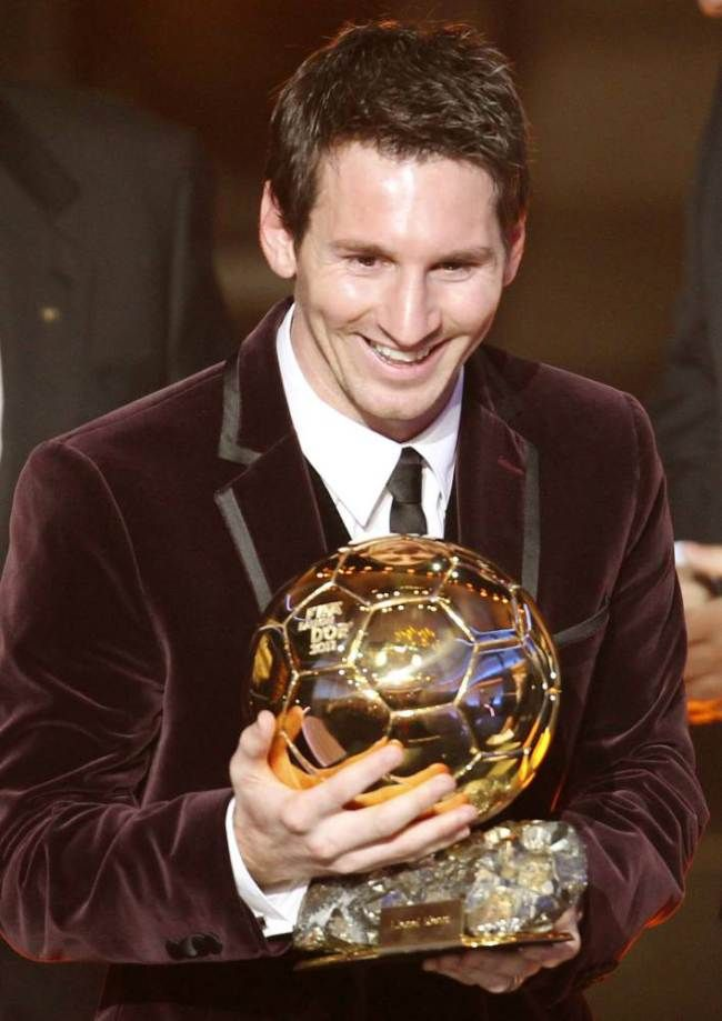 Argentina's Lionel Messi is awarded the prize for the soccer player of the year 2011 at the FIFA Ballon d'Or awarding ceremony in Zurich, Sw...