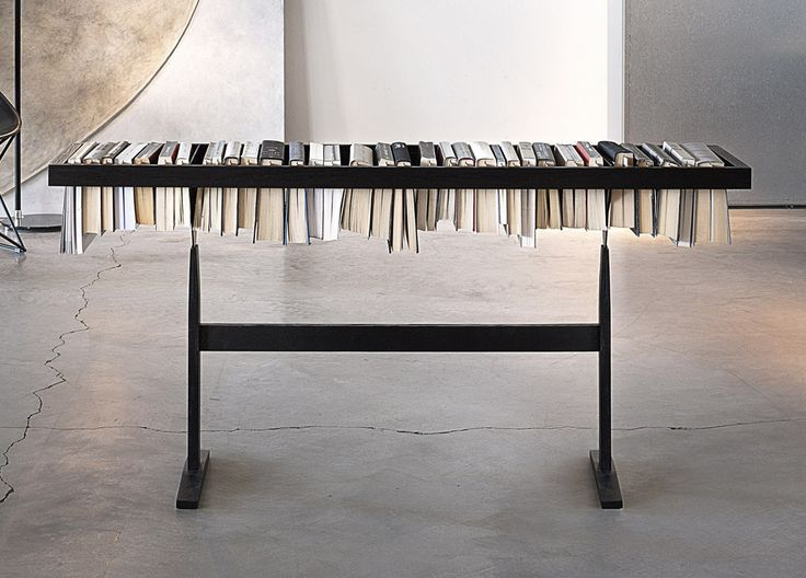 Booken Bookshelf is designed by the british duo Raw Edges for Lema. It highlights the book as an artwork and reinvents itself, becoming coffee table, shelf and bookshelf. A unique piece, style and innovation of the Lema design.