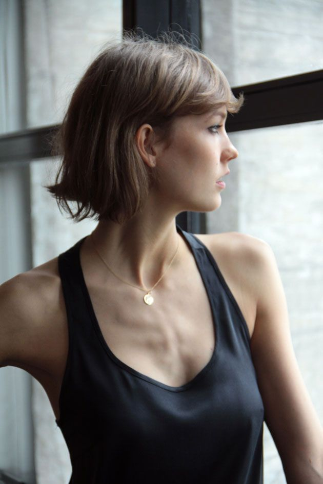 Karlie Kloss. Simple.  Can't tell about bangs . Blunt Bob . Growing Out . Longer . Lighter