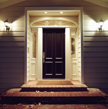 Royalty-free Image: Front door of house with lights at night