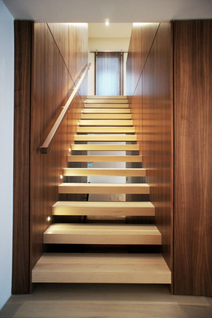 Walnut and White oak staircase by Connie Young Design.