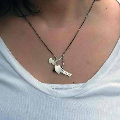 Girl on a swing necklace.