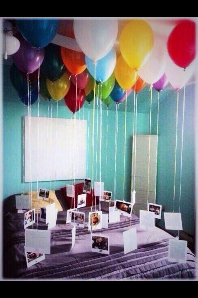Balloons with pictures attached to the bottom. Perfect birthday idea!