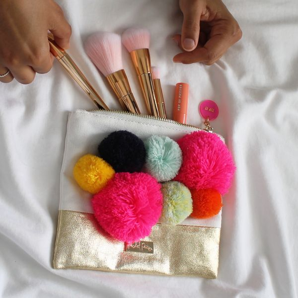 CALLING ALL POM LOVERS! MEET OUR POMALICIOUS POUCH. THE PERFECT CARRY-ALL FOR YOUR PURSE, PENS, OR HEY EVEN A NIGHT OUT WITH THE GIRLS. THIS POUCH IS WAY TOO CU