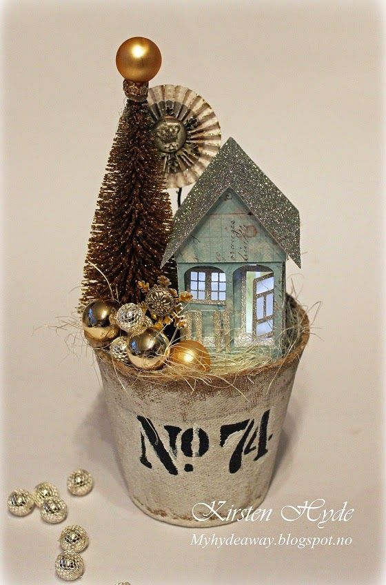 Christmas Glitter house scene in a Peat Pot. The house is made with papers from Prima. Template for the house in the blog. Made by Kirsten Hyde – Ebru Çetiner