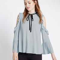 Channel the Victorian in you with this stylish and loose blouse. The perfect…