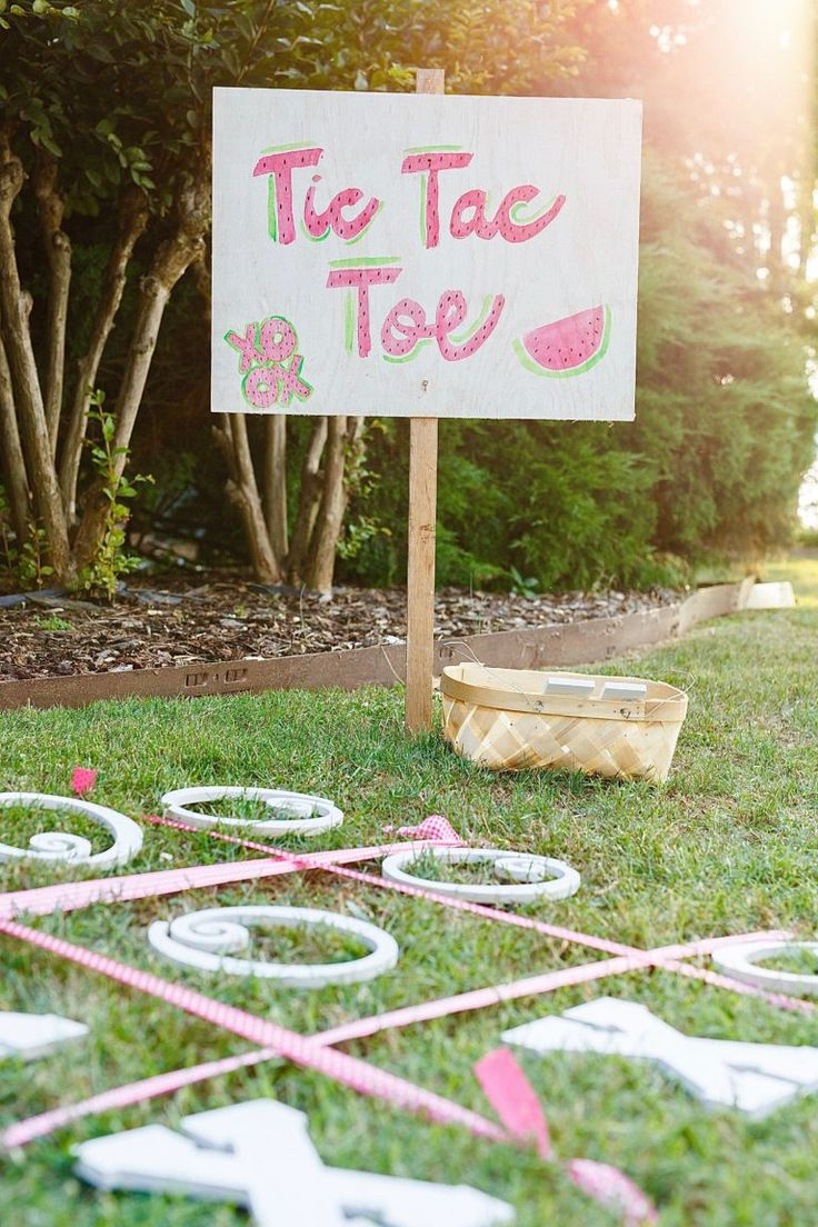 It's tic tac toe, outdoors on the grass. Super clever!