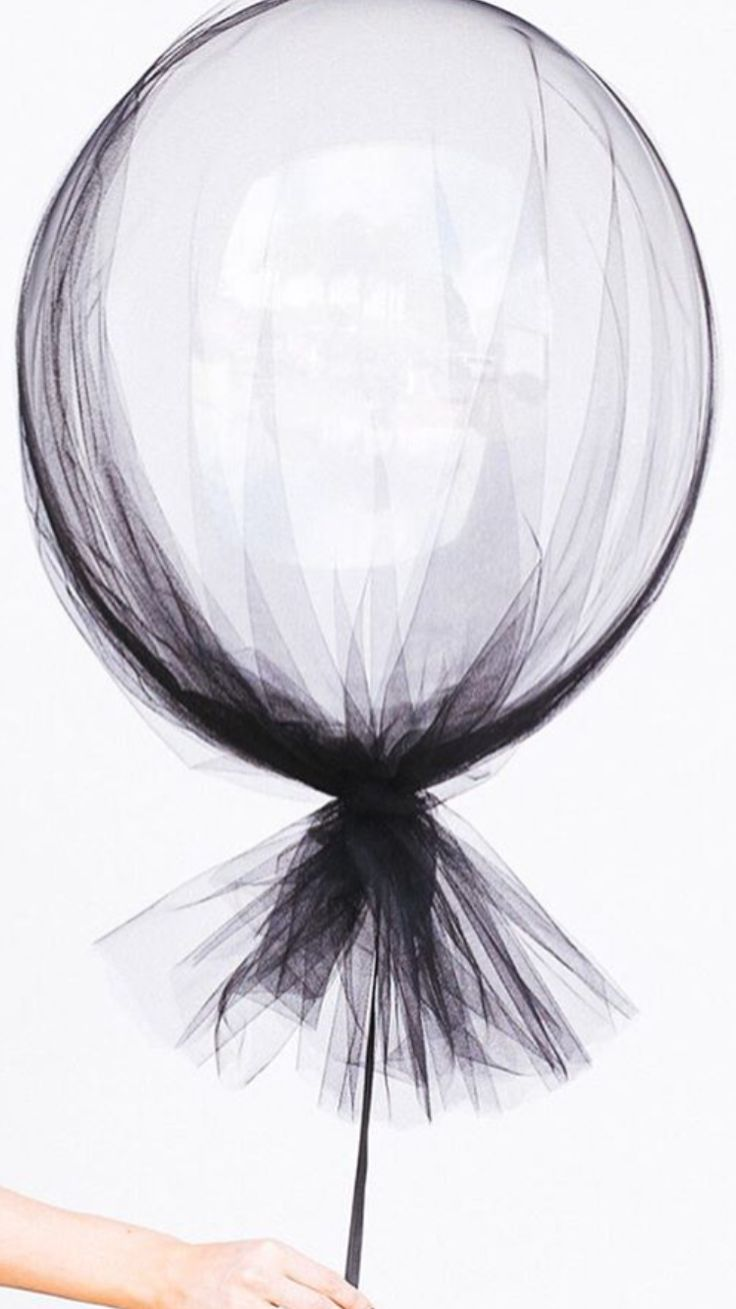 Balloon covered in black tulle